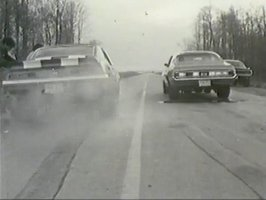 4569_1970-mercury-cougar-vs-camaro-burnout_small