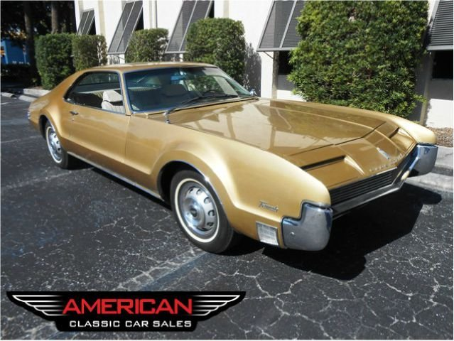 gold 1966 oldsmobile toronado for sale mcg marketplace. Black Bedroom Furniture Sets. Home Design Ideas